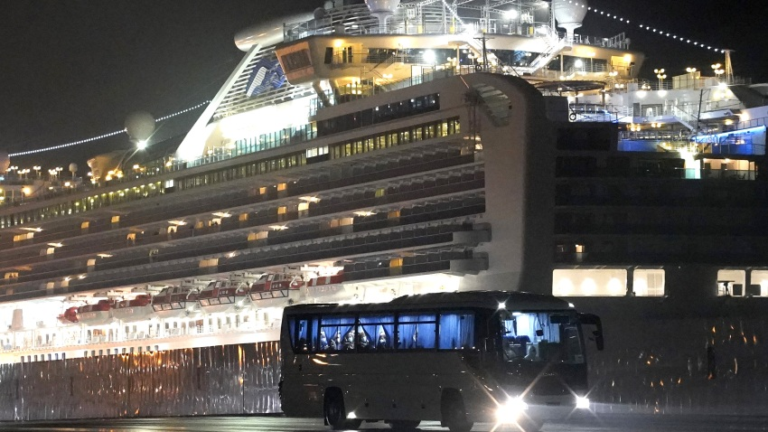 A bus with passengers believed to be U.S. citizens drives away from the Diamond Princess cruise ship, operated by Carnival Corp., docked in Yokohama, Japan, on Monday, Feb. 17, 2020.
